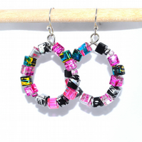 Hoop earrings with bright pink and black glass cubes