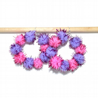 Pink and purple pompom hoop earrings