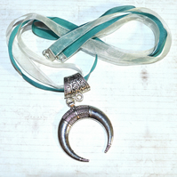 Ox horn crescent moon pendant, teal ribbon necklace