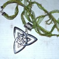Large Celtic symbol Triquetra necklace, green ribbon and cord necklace
