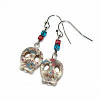 Floral printed shell skull earrings with red and teal crystal cubes