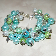 Feather charm bracelet with pastel mint and turquoise glass pearls