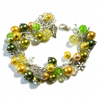 Floral charm bracelet with yellow and green beads