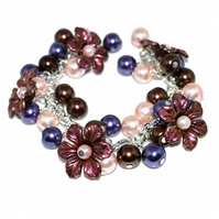 Flower cluster bracelet with brown, pink and purple glass pearls