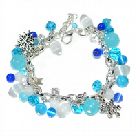 Snowflake charm bracelet with blue and white shimmer glass and crystal beads