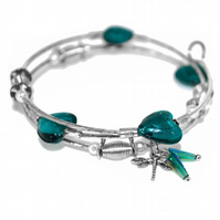Beaded wire bangle with teal hearts and dragonfly charm