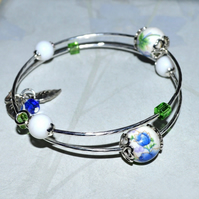 Porcelain bead wire bangle with crystal cubes and leaf charms