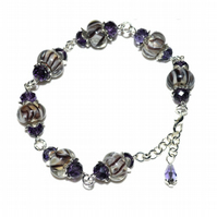 Striped lampwork glass and crystal bead bracelet