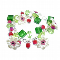 Flower cluster bracelet with white, purple and green glass pearls