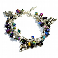 Summer unicorn charm bracelet with purple and rainbow beads