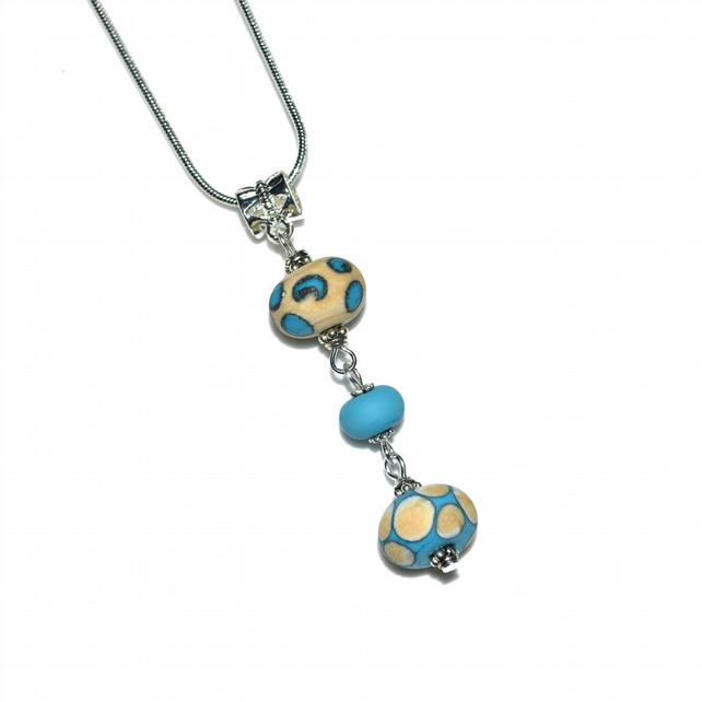 Blue and cream lampwork glass pendant necklace,
