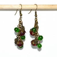 Bronze earrings with red and green frosted beads and pine cones