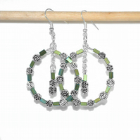 Large green hoop earrings made with Bohemian flower beads