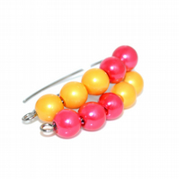 Magnetic dangle hoop hook earrings in dark coral and bright yellow