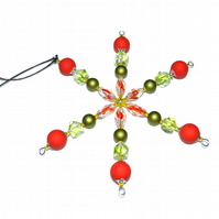Beaded Christmas star in red and green, rubber and glass xmas decoration