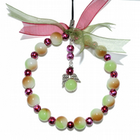 Beaded harvest angel hoop in green and red, glass bead xmas decoration