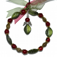 Bronze Christmas angel hoop in red and green, glass bead xmas decoration