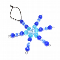 Small blue Christmas star in glass cats eye beads