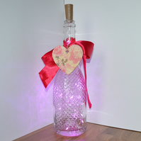 Romantic heart and ribbon lighted wine bottle centrepiece