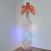 Peacock charm lighted wine bottle centrepiece