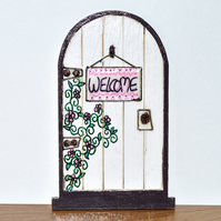 White handpainted fairy door