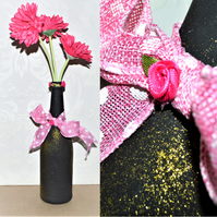 Hot pink, black and gold glitter decorated wine bottle centrepiece