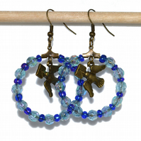 Blue bead hoop earrings with bird charms