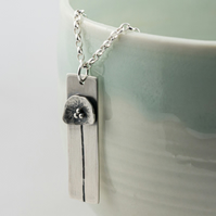 Silver poppy flower pendant necklace