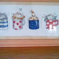 Cross-stitch cats frame