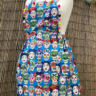 Apron in Frida Kahlo fabric with Pom-poms
