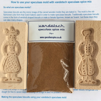Woman and man wooden mould plus vandotsch speculaas spice mix to make biscuits