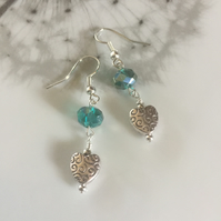 Long turquoise crystal earrings with tibetan hearts