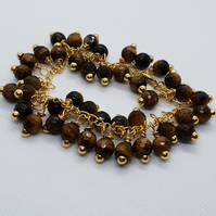 Faceted Tiger's Eye beads and gold plated bubble bracelet