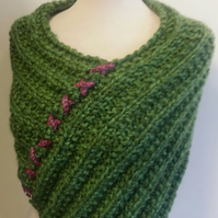Green and pink chunky knit shoulder warmer with diamante embellishment.