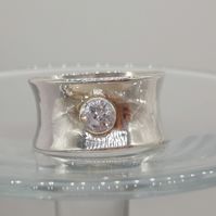 Hallmarked 925, Wide Flare Band Ring, set with a 5mm Bezel Set White Topaz