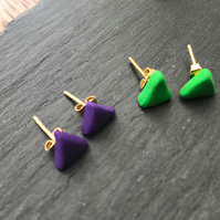 A pair of triangle stud earrings