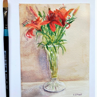 Small watercolour still life painting of red lilies arranged in glass vase
