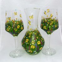 Hand painted glass carafe and two wine glasses