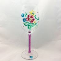 Elegant floral wine glass with glittery stem