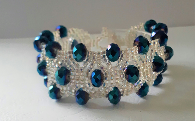 Dark blue crystal and silver-lined glass bead bracelet