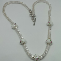 Slinky silver lined bead and Rose Bead necklace.