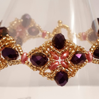 """Very Regal"" design bracelet  in purple, pink and gold"