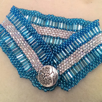 Turquoise and silver cuff style bracelet
