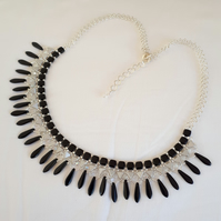Collar  style necklace in black and grey