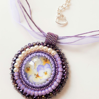 Bead embroidered Pansy Cabochon pendant on silky and cord necklace