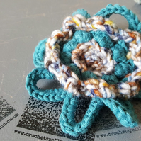 Crochet flower brooch. Handmade floral decoration.