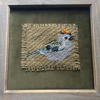 Framed hand stitched goldcrest on peanut sacking and olive green velvet