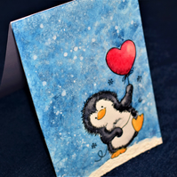 original watercolour painting penguin with heart balloon, winter christmas card