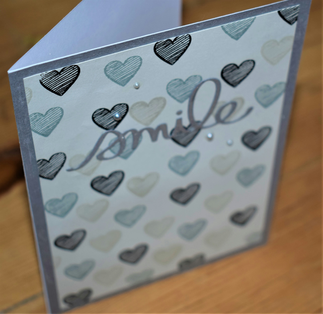 heart pattern handmade card. smile neutral colours