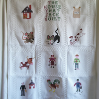 Cot blanket entitled 'The House that Jack Built'.